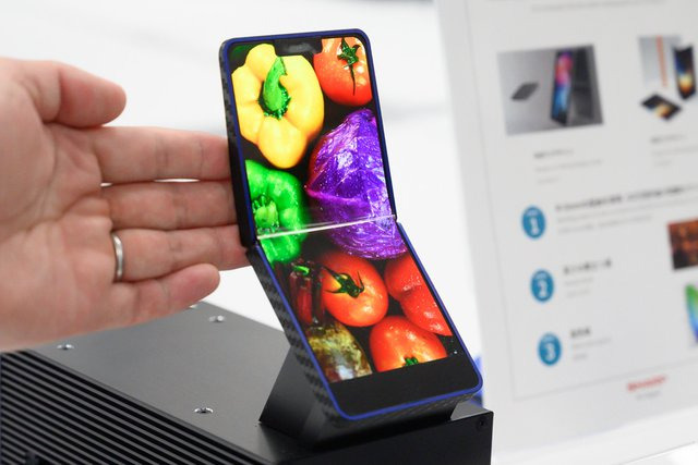 Smartphone, Product design, Product, Design, Mobile Phones, iPhone, smartphone, Gadget, Smartphone, Mobile phone, Communication Device, Portable communications device, Electronic device, Technology, Hand, Finger, Plant