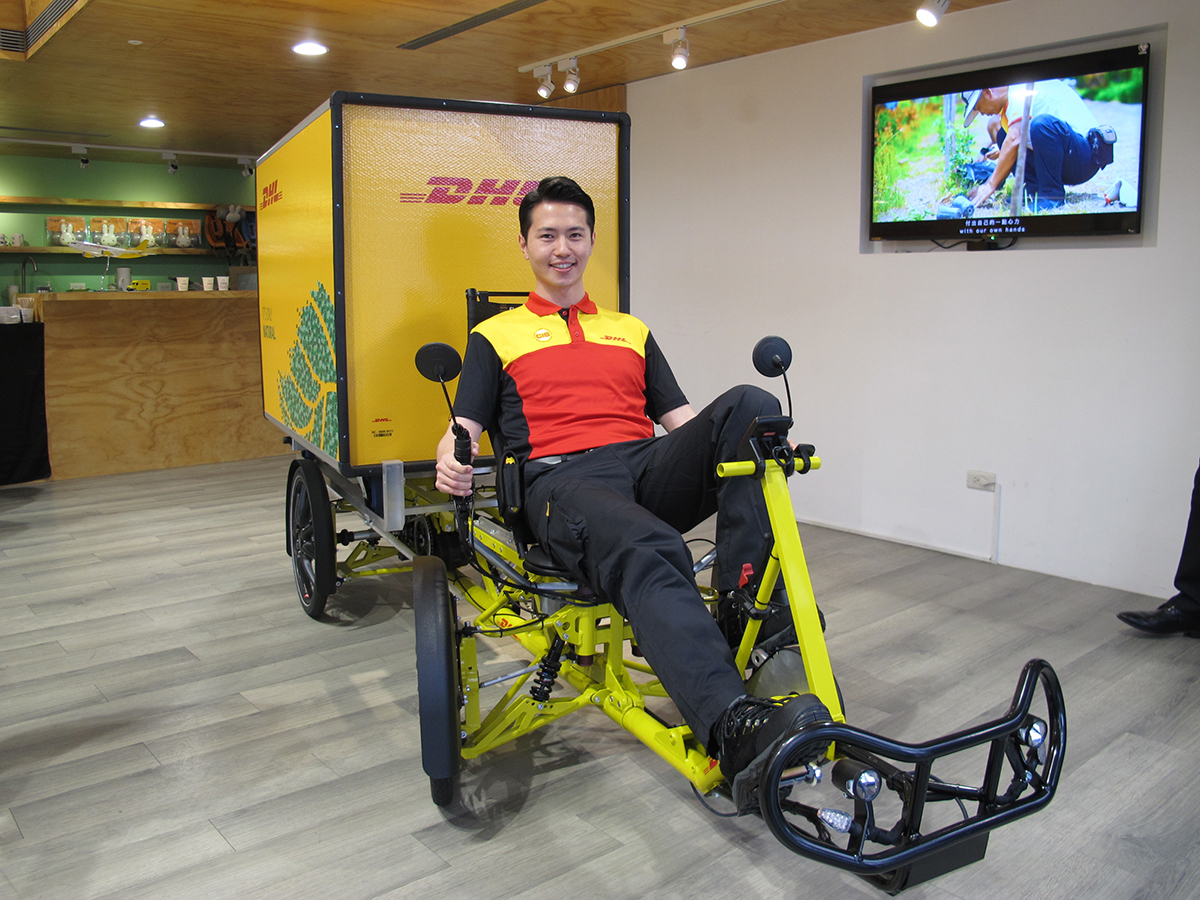 Car, Motor vehicle, Automotive design, Health, Vehicle, Design, Beauty.m, DHL EXPRESS, , dhl express, Product, Vehicle, Yellow, Bicycle, Exercise machine, Bicycle trainer, Exercise equipment, Recumbent bicycle, Room, Stationary bicycle